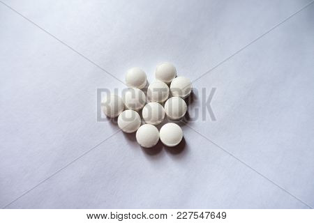 Fistful  Of Small White Vitamin K Tablets