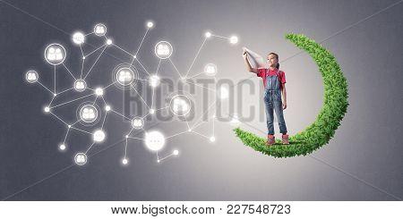 Cute Kid Girl Standing On Green Moon Throwing Paper Plane