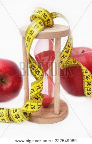 Fat Burning And Weight Loss Process. Diet And Fitness Concept. Red Apple And Tape Measure Isolated,