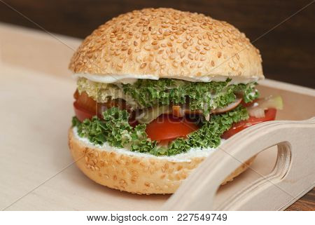 Homemade Hamburger In Wooden Box, With Fresh Vegetables On Rustic Wooden Background.