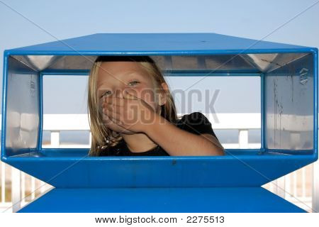 Young girl inside of a blue trash can poster