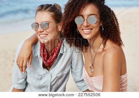 Lesbian Couple Spend Summer Vacations At Tropical Beach, Embrace Each Other And Enjoy Togetherness.