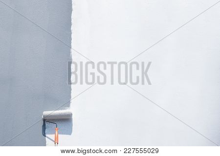 Roller Brush Painting, Worker Painting On Steel Surface Wall By The Roller Brush For Protection And