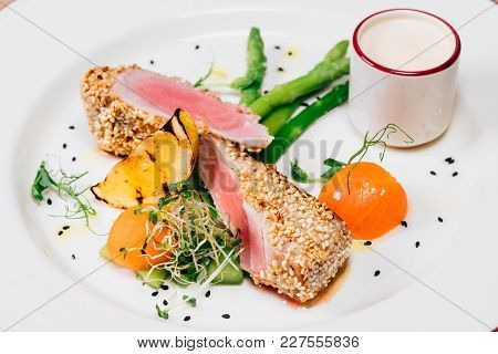 Appetizing Lightly Fried Tuna With Vegetables Close-up
