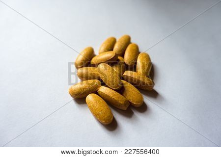 Big Oblong Orange Tablets Of Multivitamin Complex