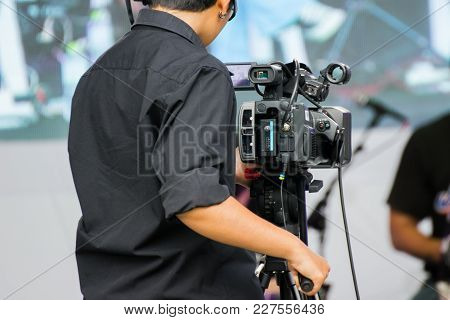 Professional Cameraman - Covering An Event To A Live And Record Video At Outdoor