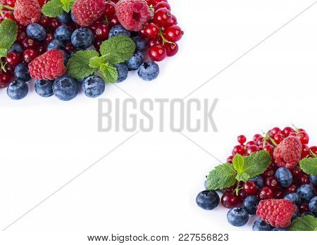 Top View. Red And Blue Berries. Ripe Blueberries, Red Currants And Raspberries On Whitebackground. B