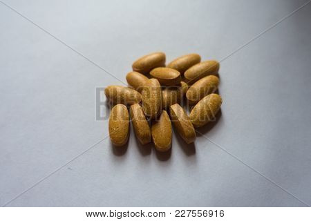 Heap Of Big Oblong Orange Multivitamin Tablets