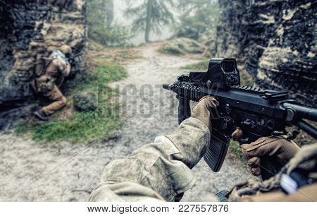 Private Military Contractors Pmc In In Action In The Rocks. Original Point Of View Pov, View In Firs