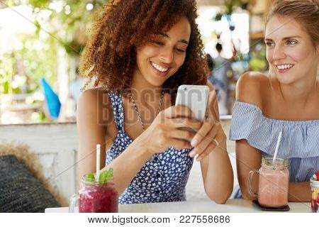 Photo Of Two Lesbians Use Modern Electronic Gadget Together, Enjoy Wireless Internet Connection At C