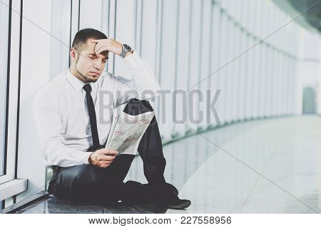 The Concept Of Job Search. A Man Is Sitting With A Newspaper.