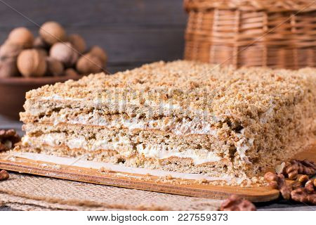 Homemade Cake With Nuts On A Wooden Board