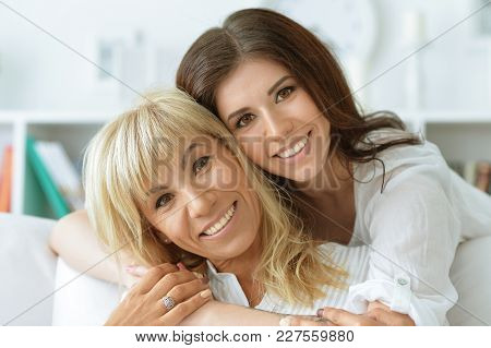 Portrait Of Middle Aged  Woman With Daughter At Home