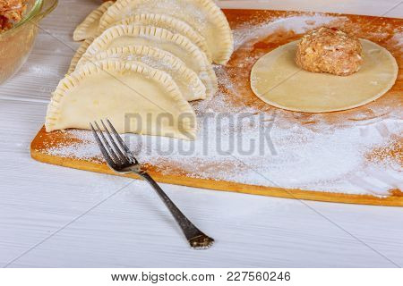 Traditional Crimean Tatar Dish- Cheburek On Wooden Background Is Ready To Fry The Cook Makes Chebure