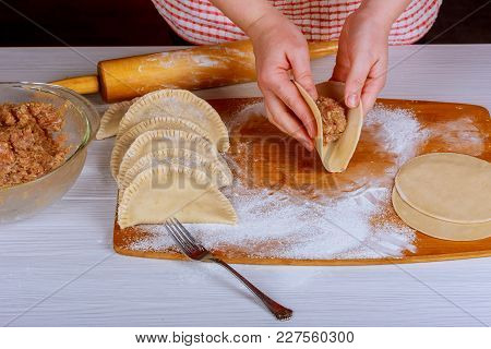 The Cook Makes Cheburek With Meat Cheburek With Meat Cooking In Boiling Oil. Caucasian Cuisine.
