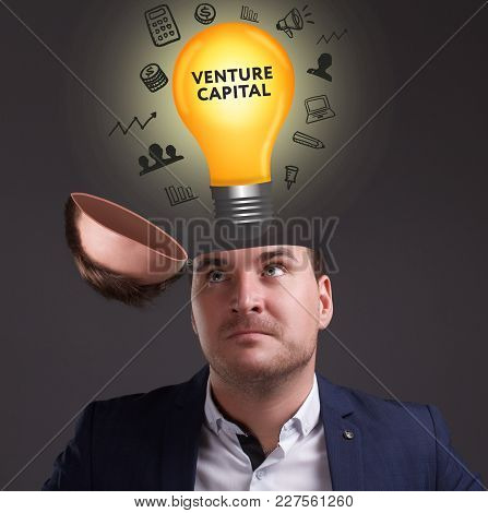 The Concept Of Business, Technology, The Internet And The Network. A Young Businessman Thinks About