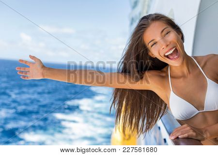 Cruise vacation on cruise travel holiday in caribbean beach. Asian girl with open arm in freedom happy excited. Tourist woman screaming of joy. Happy traveler having fun on summer vacations.
