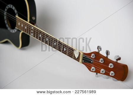 An Image Acoustic Guitar On White Background