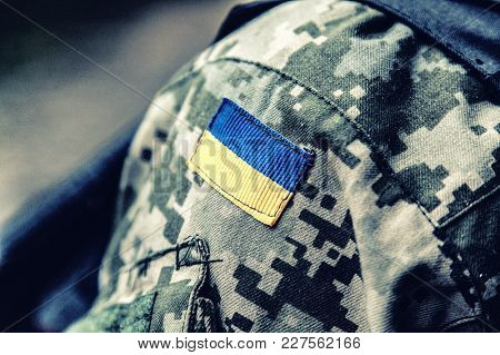 Military Badge Of Ukrainian Army With Trident And Yellow-blue Flag