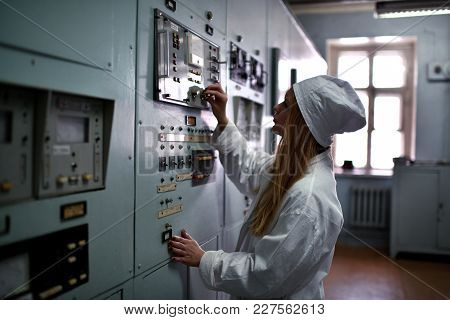 Nuclear Plant Engineer Woman Working At Thermal Power Plant Appliance Device