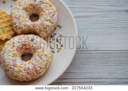 Two White Donuts With Wafers On A Plate. Cropped Image