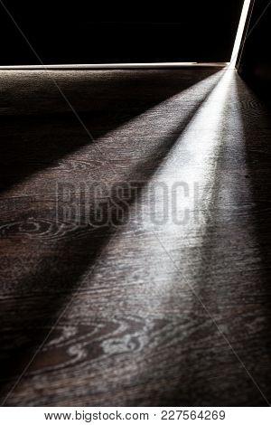 Rays Of Light From The Door In A Dark Room .