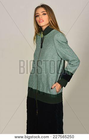 Fashion Model Pose In Studio, Beauty. Sensual Woman In Fashionable Folk Coat, Style. Fashion And Bea