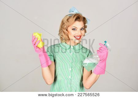 Housekeeper In Uniform With Clean Spray, Duster. Housekeeper Or Happy Wife Cleaning With Soap Bottle