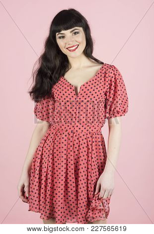 Lady Wearing Dotted Romantic Dress. Happy Girl With Cheerful Face Isolated On Light Pink Background.