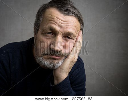 Thoughtful elderly bearded man portrait