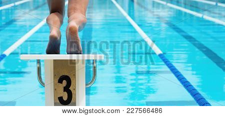 The Swimmer Jumps From The Start Block At The Start Of The Race