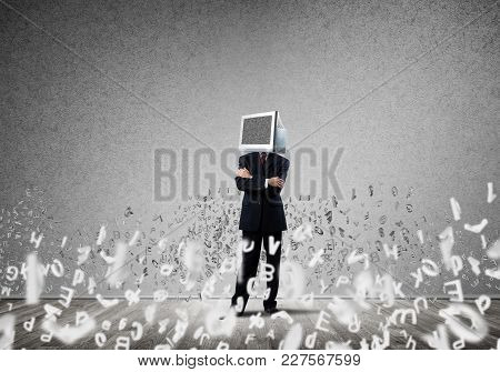 Businessman In Suit With Monitor Instead Of Head Keeping Arms Crossed While Standing Among Flying Le