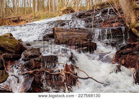 Water Cascading Over Rocks And Logs In The Alabama Backwoods