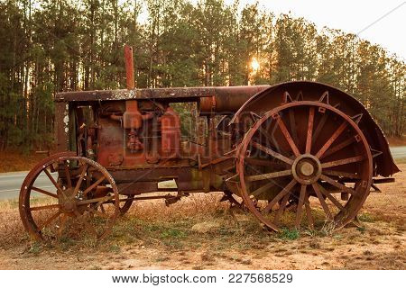 An Old Antique Tractor From Days Gone By