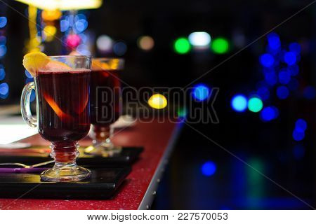 Two Glasses Of Mulled Wine On A Bokeh Background.
