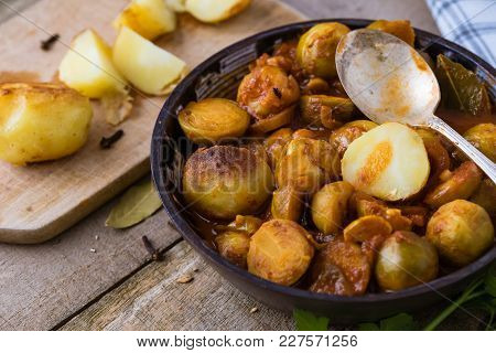 Roasted Fresh Brussels Sprouts With Potatoes In Homemade Ceramic Bowl.