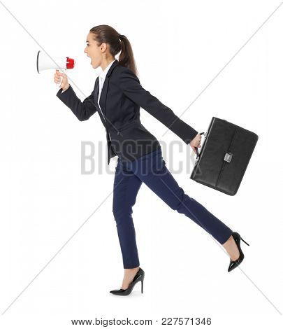 Young businesswoman with briefcase and megaphone running on white background