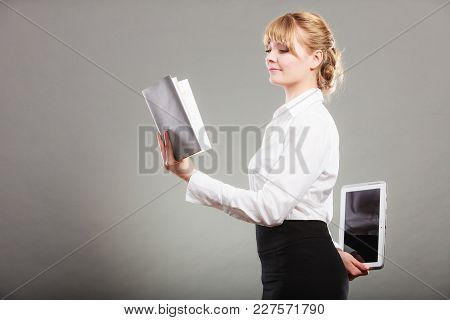 Woman Learning With Book Holding Ebook Tablet Behind Back. Choice Between Modern Educational Technol