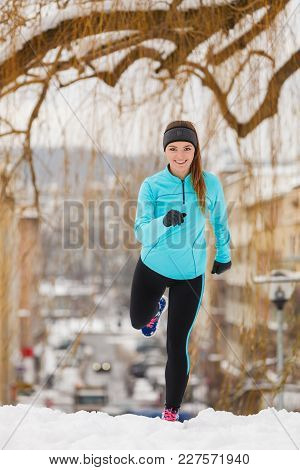 Sport Winter People Concept. Young Lady Doing Workout In Park. Beautiful Girl Jogging Around Outside