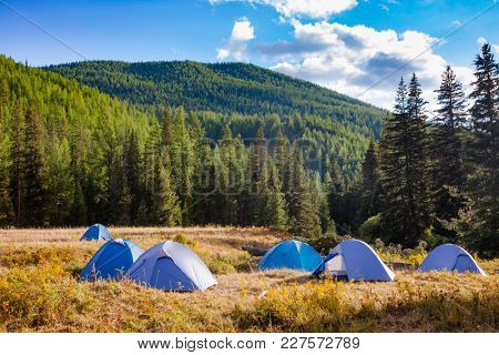 Camping tents on a river shore in wild camping, Altai Mountains, Western Mongolia