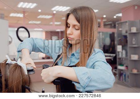 Master Hair Stylist Makes Hair Restoration Procedures. The Keratin Hair Concept.