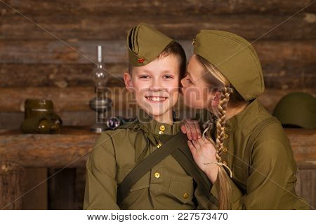 Two children in military uniforms of the Great Patriotic War. World War II