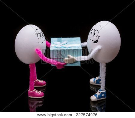 Funny Miniature Easter Egg Boy Gives A Gift Present Box To Egg Girl.