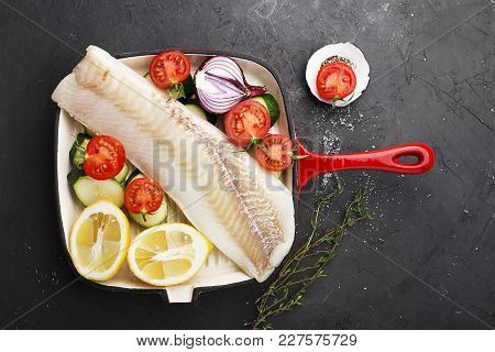 Cod. Fresh Sea White Raw Fish Before Cooking In A Frying Pan With Fresh Vegetables: Zucchini, Sweet