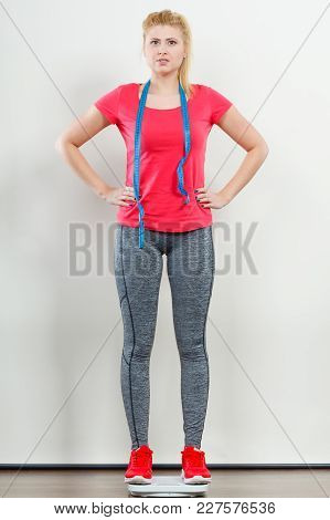 Healthy Fit Life Style, Controling Body Concept. Woman Wearing Sportswear, Leggings And Trainers Sta