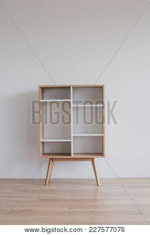 Retro Wooden Commode On White Wall Background