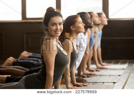 Smiling Yoga Instructor Looking At Camera Doing Fitness Stretching Backbend Exercise Together Teachi