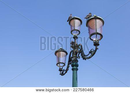 Vintage Street Lamp Against A Clear Sky. Venice, Italy