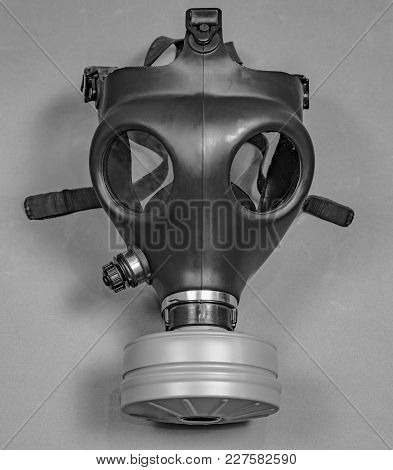 Old Vintage Gas Mask On Gray Background. Background.