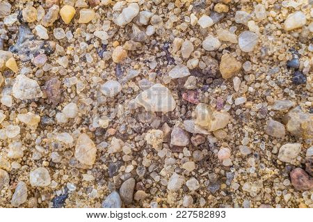 Natural Coarse Sand. Surface Grains Of Sand Close-up.